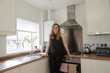 Jessica Kirby standing in her kitchen
